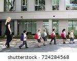 kindergarten students walking... | Shutterstock . vector #724284568
