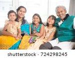 portrait of happy indian family ... | Shutterstock . vector #724298245