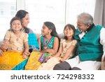 portrait of happy indian family ... | Shutterstock . vector #724298332