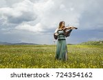 beautiful female viola player... | Shutterstock . vector #724354162