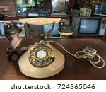 antique dial telephone in... | Shutterstock . vector #724365046