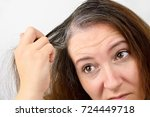 woman is checking white hair... | Shutterstock . vector #724449718