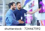 in the electronics store... | Shutterstock . vector #724467592