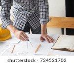 engineer hand sketching a... | Shutterstock . vector #724531702