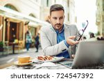businessman having breakfast... | Shutterstock . vector #724547392