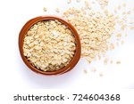 oat flakes  uncooked oats in... | Shutterstock . vector #724604368