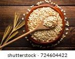 oat flakes  uncooked oats in...   Shutterstock . vector #724604422