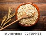 oat flakes  uncooked oats in... | Shutterstock . vector #724604485