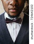 portrait of handsome african... | Shutterstock . vector #724642102