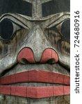 Small photo of Alaskan Totem Pole Closeup. A detail view of an Alaskan Totem pole in southeast Alaska.