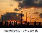 sunset silhouette of fishermen... | Shutterstock . vector #724712515