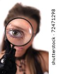 woman and magnify glass (young detective) - stock photo