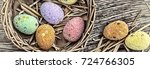 multicolored easter eggs in a... | Shutterstock . vector #724766305