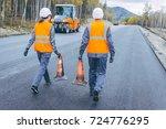 cone worker asphalting   Shutterstock . vector #724776295