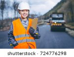 female worker road construction | Shutterstock . vector #724776298