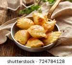 baked dumplings stuffed with... | Shutterstock . vector #724784128