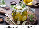 feta cheese marinated in olive... | Shutterstock . vector #724809958