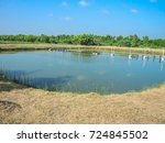 Small photo of Outdoor fish or shrimp farming pond with farm water aeration system.
