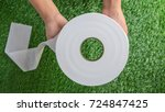 hands holding a toilet paper or ... | Shutterstock . vector #724847425