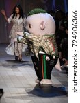 Small photo of NEW YORK, NY - SEPTEMBER 10: Cute little monster Wuba and designer Vivienne Tam walks the runway wearing Vivienne Tam Spring 2018 during New York Fashion Week on September 10, 2017 in New York City.