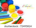 Colorful paints and pencils with copy space - stock photo