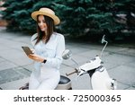 young woman using a smartphone... | Shutterstock . vector #725000365