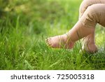 little child and green grass in ... | Shutterstock . vector #725005318