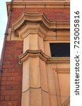 Small photo of Victorian factory architrave detail. Detail of an architrave from an English factory.