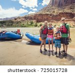 Family on a rafting trip down...