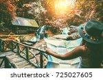 asian women travel relax in the ... | Shutterstock . vector #725027605