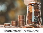 stack of coins and jar with... | Shutterstock . vector #725060092