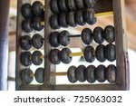 the ancient abacus used for... | Shutterstock . vector #725063032