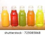 fruit juice in glass bottles...   Shutterstock . vector #725085868