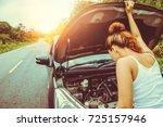 asian women the car is broken... | Shutterstock . vector #725157946
