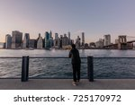 back view of young man standing ...   Shutterstock . vector #725170972