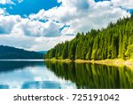 Small photo of Vidra dam lake. Vidra Lake is a storage reservoir, located in the Parang Mountains, on the Lotru River, in Valcea County, Romania.