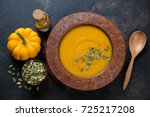 pumpkin cream soup with... | Shutterstock . vector #725217208