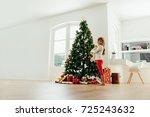 girl holding teddy bear... | Shutterstock . vector #725243632