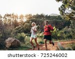 man and woman jogging on a... | Shutterstock . vector #725246002