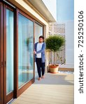 man opening sliding glass doors ...   Shutterstock . vector #725250106