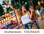 two friends at amusement park.... | Shutterstock . vector #725256325