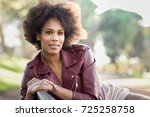 young black female with afro... | Shutterstock . vector #725258758