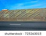 noise barrier on highway | Shutterstock . vector #725263015