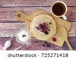 breakfast with pancakes and tea....   Shutterstock . vector #725271418