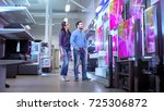 in the electronics store young... | Shutterstock . vector #725306872