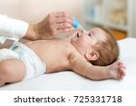 doctor hand cleans baby's nose... | Shutterstock . vector #725331718