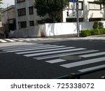 crosswalk on a road in city ... | Shutterstock . vector #725338072