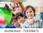 happy kids at indoor playground | Shutterstock . vector #725338672
