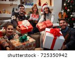 young happy people with gifts... | Shutterstock . vector #725350942