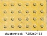tactile paving slabs texture.... | Shutterstock . vector #725360485